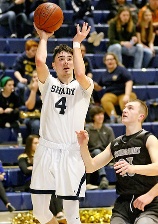 (Brad Davis/The Register-Herald) Shady Spring's Ryan Riffe puts up a short range shot as Westside's Jacob Ellis defends Wedensday night in Shady Spring.
