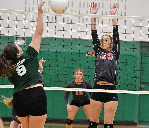 (Brad Davis/The Register-Herald) Liberty captain Madison Maynard, right, leaps to block a spike from Fayetteville's Cassidy Roles August 29 in Fayetteville.