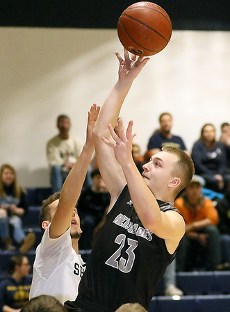 (Brad Davis/The Register-Herald) Westside's Jacob Ellis drives to the basket as Shady Spring's Cole Honaker defends Wednesday night in Shady Spring.
