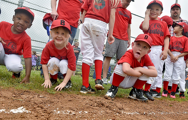 (Brad Davis/The Register-Herald) Young ballplayers from the Bulldogs notice the camera and react accordingly as they struggle to keep still while waiting in line during team introductions, part of Beckley Little League's Tee Ball Opening Day ceremonies Saturday afternoon.