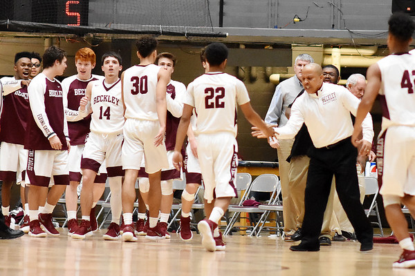 Woodrow celebrates after Capital called a timeout during the second quarter of their basketball sectional championship against Tuesday in Beckley. (Chris Jackson/The Register-Herald)