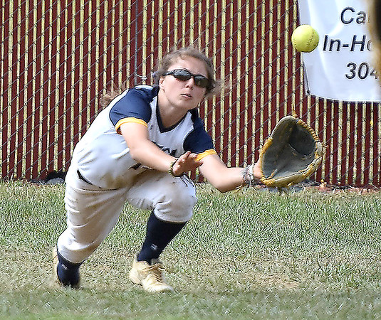 (Brad Davis/The Register-Herald) WVU Tech center fielder Skylar Connelly makes a diving catch during the second game of a doubleheader against Cincinnati Christian Saturday afternoon at Woodrow Wilson High School.
