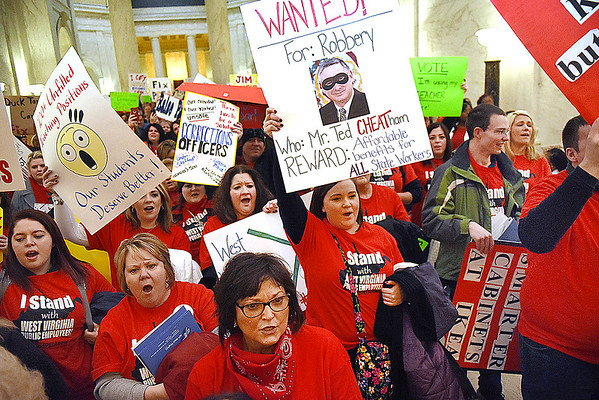 Teachers acsross the state rally in front of the Senate chambers at the State Capitol in Charleston Friday morning. They filled the gallery and others chanted outside the chamber as the state Senate unanimously passed a bill that would increase teachers and certain state employees salaries by 1 percent.<br /> (Rick Barbero/The Register-Herald)