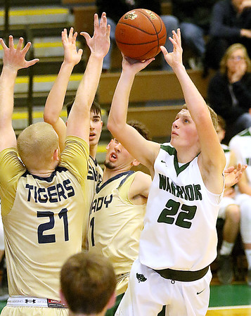 (Brad Davis/The Register-Herald) Wyoming East's McQuade Canada drives to the basket as Shady Spring defenders Logan Cook (#21), Ryan Riffe, middle and Cole Honaker converge on him Friday night in New Richmond.