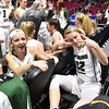 (Brad Davis/The Register-Herald) Wyoming East senior Gabby Lupardus, right, was in good spirits despite going down with an injury during their opening round state tournament game against Lincoln Wednesday. Teammate Skylar Davidson, who was injured herself earlier in the season, sits with her at left.