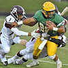 (Brad Davis/The Register-Herald) Greenbrier East ball carrier Jaylon Battaile is taken down by Woodrow Wilson defenders Jacobe Harville (#15) as other teammates swarm him Friday night in Fairlea.