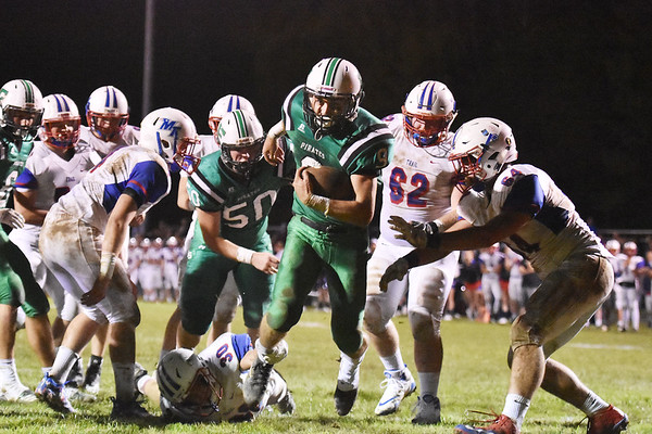 Fayettevill'es Jordan Dempsey (9) breaks lose from a tackle to score Fayetteville's single touchdown of their high school football game against Midland Trail Friday in Fayetteville. Midland Trail won 26-10. (Chris Jackson/The Register-Herald)