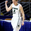 (Brad Davis/The Register-Herald) Wyoming East senior Kara Sandy reacts after hitting a three-pointer during the Lady Warriors' State Tournament win over Wayne Friday morning at the Charleston Civic Center.