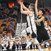 Puett Elijah, of Westside, left, drives to the basket against, Sean Hanshaw, of Winfield in the quarter-final game of the Class AA Boys State Basketball Tournament held at the Charleston Civic Center. Winfield won 68-65<br /> (Rick Barbero/The Register-Herald)