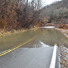 (Brad Davis/The Register-Herald) A section of Coal City Road near Rhodell remained covered by flood waters Sunday afternoon.