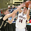 (Brad Davis/The Register-Herald) Woodrow Wilson's Bryce Radford looks for an open teammate as University's Austin Forbes defends during Big Atlantic Classic action Saturday the Beckley-Raleigh County Convention Center.