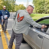 (Brad Davis/The Register-Herald) State senator Richard Ojeda meets and greets with employees of Beckley's Federal Correctional Institution as they come and go outside the gates along with American Federation of Government Employees Local 404 Secretary/Treasurer Dan Reese, middle, and fellow  union member Charles Yates Wednesday afternoon near Beaver.