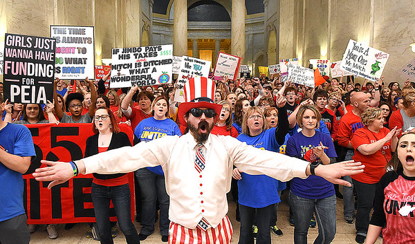 Parry Casto, teacher Explorer Academy in Huntington rallying with teachers and service personnel  in front of the Senate Chambers at the State Capitol in Charleston during Day 7 of the teachers walkout.<br /> (Rick Barbero/The Register-Herald)