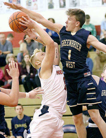 (Brad Davis/The Register-Herald) Greenbrier West's Noah Midkiff blocks the shot off a drive from Independence's Blake Stone Friday night in Coal City.