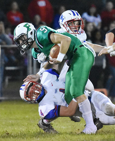 Fayetteville's Jordan Dempsey (9) is tackled by Midland Trail's Nathan Hanshew (4) during their high school football game Friday in Fayetteville. (Chris Jackson/The Register-Herald)