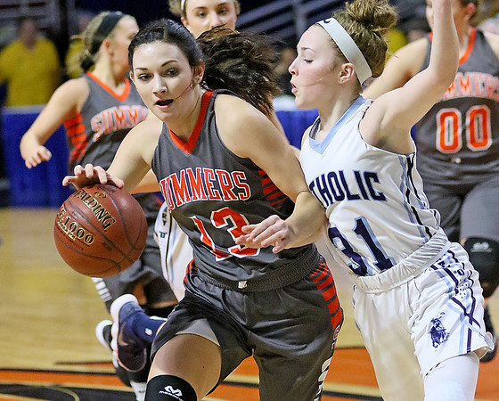 (Brad Davis/The Register-Herald) Summers County's Hannah Taylor drives up the court as Parkersburg Catholic's Madeline Huffman defends Thursday night at the Charleston Civic Center.