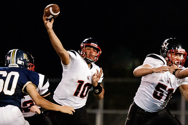 Oak Hill Quarterback, Khori Bass releases a pass during a comeback drive that would even the score 14 to 14 in the second quarter. Chad Foreman for the Register-Herald.