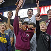 (Brad Davis/The Register-Herald) Woodrow Wilson students notice the camera during State Volleyball Tournament action Friday evening at the Charleston Civic Center.