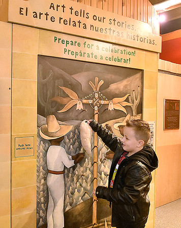 """(Brad Davis/The Register-Herald) Eight-year-old Blake Pugalee checks out the Youth Museum's new exhibit, """"Framed, Step into the Art,"""" November 24."""