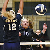 (Brad Davis/The Register-Herald) James Monroe's Gracie Mann spikes the ball as Shady Spring's Bradlea Hayhurst defends Thursday night in Shady Spring.
