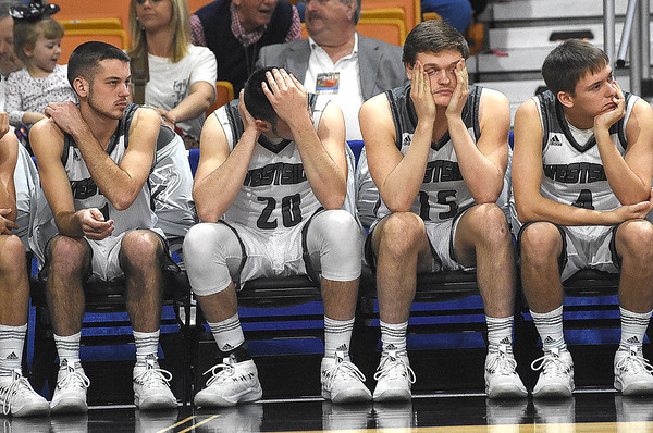 Westside bench react after losing to Winfield in the quarter-final game of the Class AA Boys State Basketball Tournament held at the Charleston Civic Center. Winfield won 68-65<br /> (Rick Barbero/The Register-Herald)