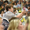 (Brad Davis/The Register-Herald) A family member angles for photos during Westside's 2018 commencement ceremony Sunday afternoon in Clear Fork.