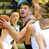 (Brad Davis/The Register-Herald) Westside's Corey Hatfield works underneath as Wyoming East's Evan Preece defends Saturday night in New Richmond.