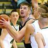 (Brad Davis/The Register-Herald) Westside's Corey Hatfield works underneath as Wyoming East's Evan Preece defends Saturday night in New Richmond.