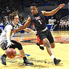 Jon Blankenship, of Tug Valley, left, and Caleb Clark, of Greater Beckley Christian go after a loose during the quarter-final game of the Class A Boys State Basketball Tournament held at the Charleston Civic Center. Tug Valley won 83-52<br /> (Rick Barbero/The Register-Herald)