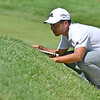 (Brad Davis/The Register-Herald) Xander Schauffele, last year's winner, gets over into a bunker to see the slope of the green prior to an upcoming putt during the Military Tribute at The Greenbrier Sunday afternoon in White Sulphur Springs.