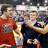 (Brad Davis/The Register-Herald) Indy wrestling legends Noah Adams, far right, and Alex Daniels, left, hang out with current wrestler Haegan Harvey and the rest of their former team prior to the start of State Wrestling Tournament action Saturday night at the Big Sandy Arena.