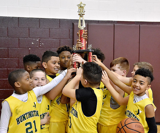 (Brad Davis/The Register-Herald) The Huntington Gators celebrate their fifth grade Biddy Buddy Championship game victory over Tug Valley Sunday afternoon at Woodrow Wilson High School.