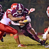 (Brad Davis/The Register-Herald) Woodrow Wilson's Micah Hancock rumbles ahead as Parkersburg defender Crocket Wade tries to bring him down Friday night in Beckley.
