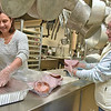 (Brad Davis/The Register-Herald) Church members Donna Cook, left, and Mary Thomas chop ham and put it into pans as they and a crew of fellow members prepare United Methodist Temple's annual Community Christmas Dinner Saturday night inside The Place. As they do every year, United Methodist Temple will utilize an army of volunteers young and old to feed well over 500 people in the area, and anyone is welcome. The dinner begins at 11:00 a.m. at The Place and runs until 2:00 p.m.
