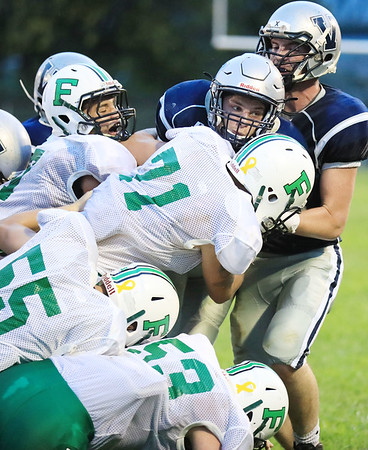 A wall of Fayetteville defenders bring down Valley quarterback Adam Falbo (9) during the second quarter high school football game Friday in Smithers. (Chris Jackson/The Register-Herald)