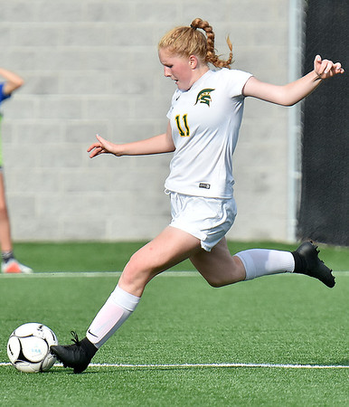 (Brad Davis/The Register-Herald) Greenbrier East's Kate Perkins winds up for a strike Friday evening at the YMCA Paul Cline Memorial Soccer Complex.