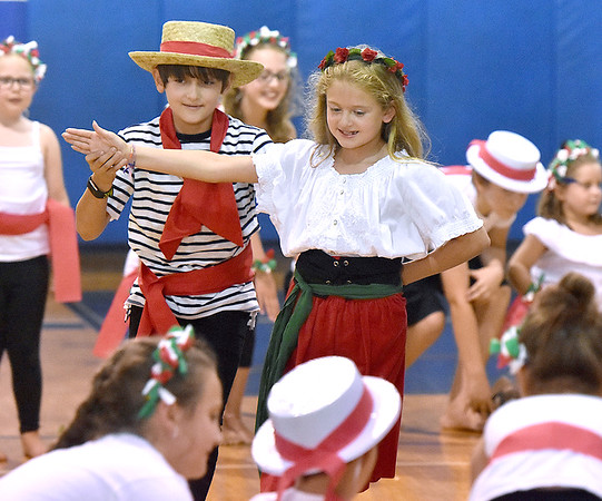 """(Brad Davis/The Register-Herald) Young actors sing and dance through scenes of their special end of summer play called """"Campo di Bambini,"""" an Italian-themed show to cap off St. Francis de Sales Catholic School's annual summer day camp Thursday evening in the school's gym."""
