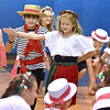 "(Brad Davis/The Register-Herald) Young actors sing and dance through scenes of their special end of summer play called ""Campo di Bambini,"" an Italian-themed show to cap off St. Francis de Sales Catholic School's annual summer day camp Thursday evening in the school's gym."