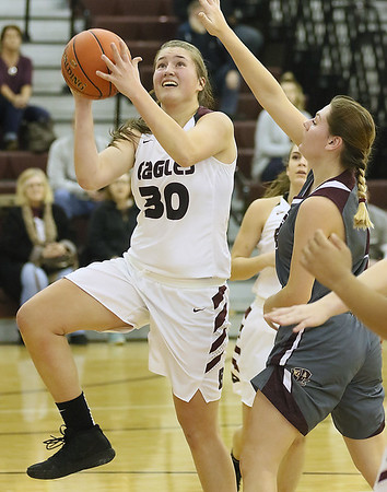 (Brad Davis/The Register-Herald) Woodrow Wilson's Laken Ball drives and scores as George Washington's Lauren Harmison defends Thursday night in Beckley.
