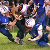 (Brad Davis/The Register-Herald) Richwood ball carrier Jeremiah Johnston is taken down by Midland Trail defenders Nathan Hanshew, left, and Trevor Maichle Friday night in Hico.