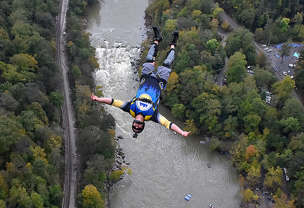 (Brad Davis/The Register-Herald) A B.A.S.E. jumper enjoys a relaxing descent towards the New River during Bridge Day Saturday in Fayetteville.