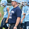 (Brad Davis/The Register-Herald) Meadow Bridge head coach Dwayne Reichard monitors his team during preseason football practice Wednesday afternoon.