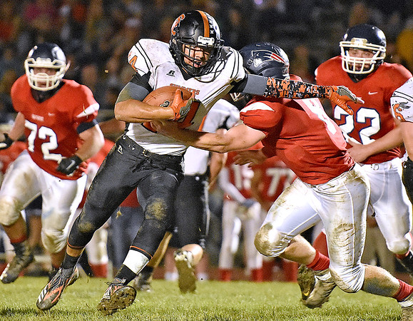 (Brad Davis/The Register-Herald) Summers County's Christian Pack carries the ball as Independence defender Hunter Williams tries to bring him down Friday night in Coal City.