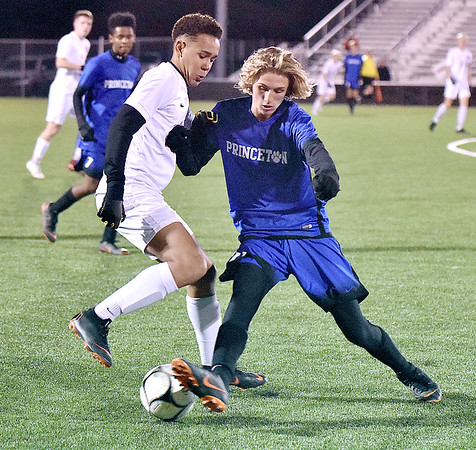 (Brad Davis/The Register-Herald) George Washington's Mouhammad Sissoko, left, battles for possession with Princeton's Ryan Burks Thursday night at the YMCA Paul Cline Memorial Sports Complex.