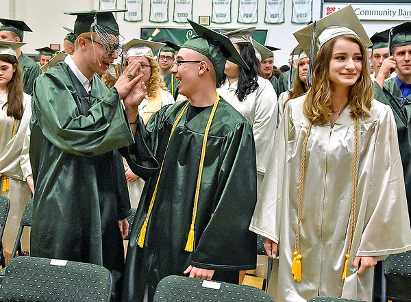 (Brad Davis/The Register-Herald) Graduating Wyoming East seniors high five during the school's 2018 Commencement Ceremony Sunday afternoon in New Richmond.