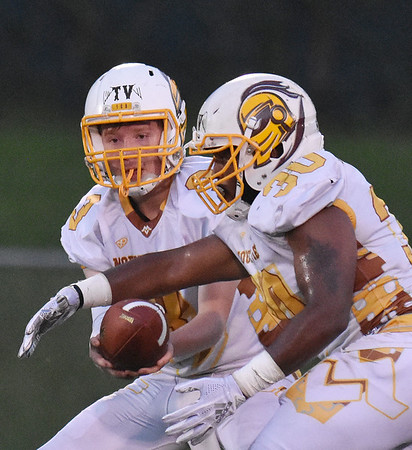 Mount View's Micah McLaughlin (8) hands-off to Elijah Barner (30) during their high school football game Thursday in Hinton. (Chris Jackson/The Register-Herald)
