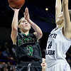 (Brad Davis/The Register-Herald) Wyoming East's Katie Daniels drives and scores as North Marion's Brielle Osborne defends Saturday afternoon at the Charleston Civic Center.