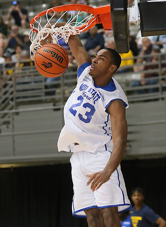 (Brad Davis/The Register-Herald) Mid-State Ford's Anthony Pittman (Capital) throws down a jam during the Scott Brown Classic dunk contest Saturday night at the Beckley-Raleigh County Convention Center.