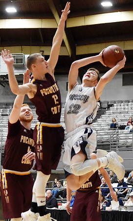 Valley's Nick Gipson (22) goes up for a shot as Pocahontas County's Logan Dilley (12) tries to block him during their Big Atlantic Classic Tournament game Tuesday in Beckley. (Chris Jackson/The Register-Herald)