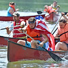 (Brad Davis/The Register-Herald) Participants of a mixed doubles heat compete for glory on the Greenbrier River as they paddle ferociously in an effort to be the first across the line during the annual Alderson Canoe Races Sunday afternoon, part of the town's yearly 4th of July festivities.